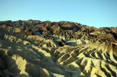 Death Valley waves. Dawn shadows highlight waves in desert sand hills stock photo