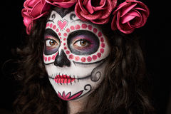 Death woman face. Close up of death woman face with skull isolated on black Royalty Free Stock Images