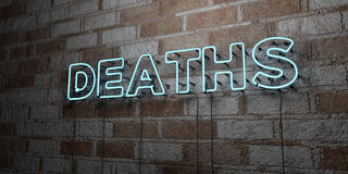 DEATHS - Glowing Neon Sign on stonework wall - 3D rendered royalty free stock illustration. Can be used for online banner ads and direct mailers Stock Image