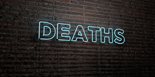 DEATHS -Realistic Neon Sign on Brick Wall background - 3D rendered royalty free stock image. Can be used for online banner ads and direct mailers Stock Photos