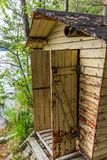 Deatil of an old wooden changing cabin on the shore of the Saimaa lake in Finland - 3 stock photo