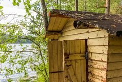 Deatil of an old wooden changing cabin on the shore of the Saimaa lake in Finland - 2 stock image