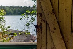 Deatil of an old wooden changing cabin on the shore of the Saimaa lake in Finland - 7 stock images