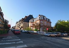 A typical street corner in the city of Deauville, Calvados department of Normandy, France. Beautiful spring morning landscape. DEAUVILLE, FRANCE-MAY 05,2018: A Stock Photography