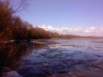 Debacle on the river. In spring with trees and clouds Royalty Free Stock Photos
