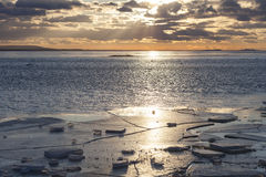 Debacle. Sunset near a  frozen lake Royalty Free Stock Images