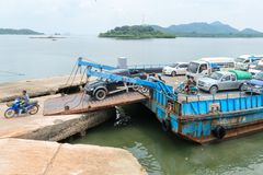 Debarkation of ferry boat vessel for passengers and cars in Thai. LANTA, KRABI, THAILAND - 17 OCT 2014: Debarkation of ferry boat vessel for passengers and cars Royalty Free Stock Photography