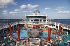 Debarking cruise ship. Vista across the pool area of a huge debarking cruise ship