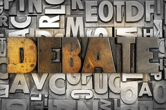 Debate. The word DEBATE written in vintage letterpress type stock photo