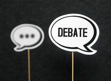 Debate, dialog, communication and education concept. Talking about political opinions. Two cardboard speech bubbles stock photos