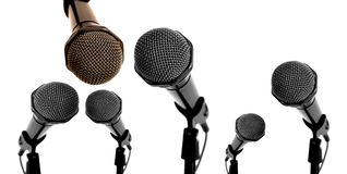 Debate scene. Panoramic view of different size microphones in like debate scene stock photos