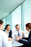 Debating. Image of confident colleagues sharing new ideas at meeting Stock Photography