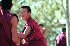 Debating monks in Tibet. Tibetan monks at Sera monastery debating in the courtyard Royalty Free Stock Image