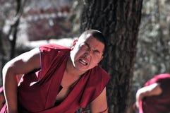 Debating monks in Tibet. Tibetan monks at Sera monastery debating in the courtyard Stock Photo