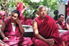 Debating monks in Tibet. Tibetan monks at Sera monastery debating in the courtyard Stock Photos