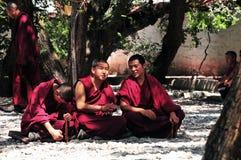 Debating monks in Tibet. Tibetan monks at Sera monastery debating in the courtyard Royalty Free Stock Images
