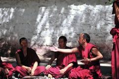 Debating monks in Tibet. Tibetan monks at Sera monastery debating in the courtyard Royalty Free Stock Photos