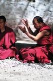 Debating monks in Tibet. Tibetan monks at Sera monastery debating in the courtyard Royalty Free Stock Photo