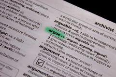 Debatteer woord of uitdrukking in een woordenboek royalty-vrije stock foto