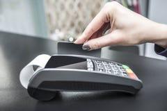 Debit card swiping on pos terminal. Stock Photography