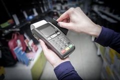 Debit card swiping on pos terminal. Stock Image