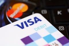 Debit cards business concept. PRAGUE, CZECH REPUBLIC - DECEMBER 12, 2016: VISA and MasterCard payment debit cards put on black keyboard. VISA and MasterCard royalty free stock image