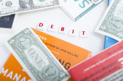 Debit On Letter Pieces Stock Photo