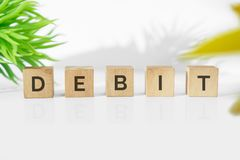 DEBIT word on wood blocks. Business and finance concept Royalty Free Stock Photos