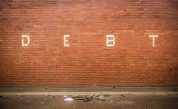 Debito sul muro di mattoni rosso Fotografie Stock