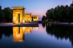 Debod Temple Reflected in the Water at Dusk, Madrid. Debod temple and his reflection in the water at the blue hour. This temple has been donated to Madrid Royalty Free Stock Images
