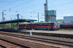 DEBRECEN, HUNGARY, MAY 12, 2016. City landscape view of train station of Debrecen, Hungary with railways and arriving train Royalty Free Stock Photos