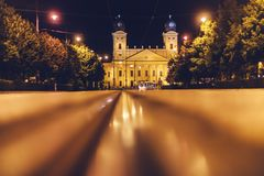 Debrecen, Hungary view of the city center, at night, with reflection of tram tracks, beautiful city landscape stock photography