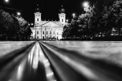 Debrecen, Hungary view of the city center, at night, with reflection of tram tracks, beautiful city landscape, Black and white stock photography