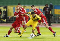 Debrecen vs. FC Metalist Kharkiv 0:5. BUDAPEST - SEPTEMBER 16: Varga (L,33), Kiss (R,30) of Debrecen and Cleiton Xavier (M,10) of Metalist in action during Royalty Free Stock Photos