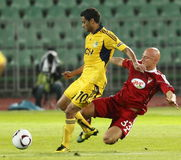 Debrecen vs. FC Metalist Kharkiv 0:5. BUDAPEST - SEPTEMBER 16: Varga (R,33 )of Debrecen tries get the ball against Cleiton Xavier (L,10) of Metalist during Royalty Free Stock Photos