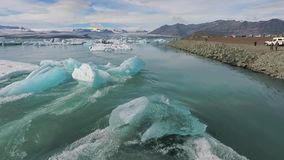The debris of blue glaciers near the shore in the ocean. Andreev. stock footage