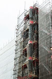 Debris chute and scaffolding. At construction site Royalty Free Stock Photos