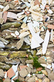 Debris after the demolition of a building. With asbestos illegally abandoned on it Stock Image