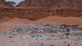 Debris in the Desert of Egypt. Garbage in the Desert of Egypt. Dirty Sahara. Broken bottles, plastic, trash polyethylene and other lies on the sand in the desert stock video