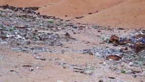 Debris in the Desert of Egypt. Garbage in the Desert of Egypt. Dirty Sahara. Broken bottles, plastic, trash polyethylene and other lies on the sand in the desert stock footage