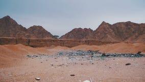 Debris in the Desert of Egypt. Garbage in the Desert of Egypt. Dirty Sahara. Broken bottles, plastic, trash polyethylene and other lies on the sand in the desert stock video footage