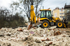 Debris and excavator Royalty Free Stock Images