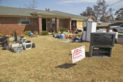 Debris in front of house heavily hit Stock Photography