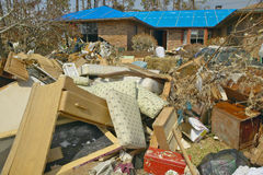 Debris in front of house heavily hit by Hurricane Stock Image