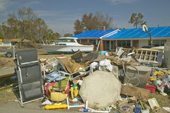 Debris in front of house heavily hit by Hurricane Ivan in Pensacola Florida Royalty Free Stock Image