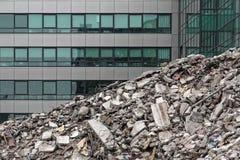 Debris. House demolition debris next to modern buildings Royalty Free Stock Image