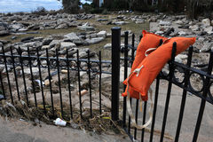 Debris and life jacket at Manhattan beach. BROOKLYN, NY - OCTOBER 29: Debris and stones litters the Manhattan beach neighborhood due to flooding from Hurricane Royalty Free Stock Photo