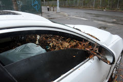 Debris litters inside abandoned car Royalty Free Stock Photo