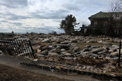 Debris litters the Manhattan beach. BROOKLYN, NY - OCTOBER 29: Debris and stones litters the Manhattan beach neighborhood due to flooding from Hurricane Sandy in Royalty Free Stock Photos