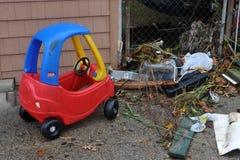 Debris littersand toy on the ground. BROOKLYN, NY - OCTOBER 29: Debris littersand toy on the ground in the Sheepsheadbay neighborhood due to flooding from Stock Photos